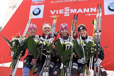 On the podium at World Cup in Gallivare, Sweden, US Women Cross Country Ski Team - Jessie Diggins, Holly Brooks, Kikkan Randall, Liz Stephen.
