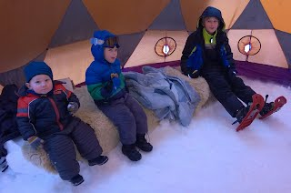Kids chillin' on the snow-couch